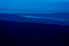 Blue Evening Hilly Landscape At The Edge Of A German Low Mountain Range With Fir Forests, Blue Hour
