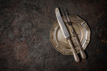 Vintage Silver Fork And Knife On Plate
