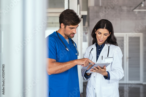 Doctor and nurse discussing report Wallpaper Mural