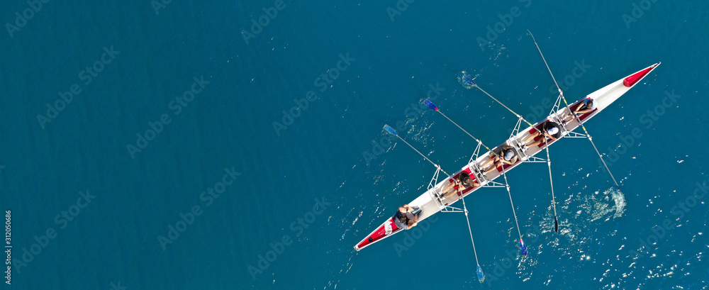 Fototapeta Aerial drone ultra wide photo of sport canoe with young team of athletes practising in deep blue open ocean sea