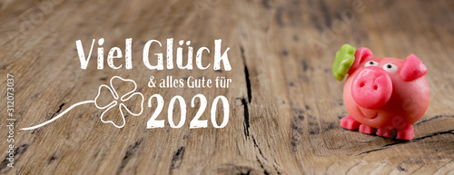 New year card 2020, german language  -  Good luck and best wishes for 2020 -  Marzipan pig on rustic wooden background  -  Good luck symbol - 312073037
