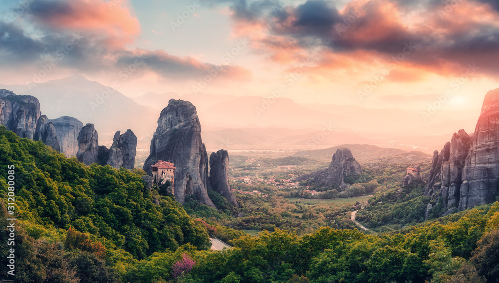Wonderful Panoramic view of the rocks and monasteries of Meteora, Greece. Mysterious Sunny Morning with colorful sky, during sunrise. Awesome Nature Landscape. Amazing Greece. Popular travel location.
