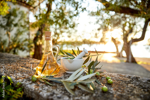 Fototapeta olive oil with fresh olives and leaves obraz