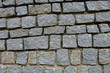 The texture of the stone walls of the old city of Europe, bricks made of granite and stones.