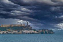 Alcatraz Under Stormy Clouds In San Francisco Bay