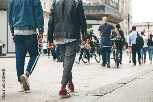 obraz PCV People walk down the street in Milan in Italy. Everyday city life or urban lifestyle