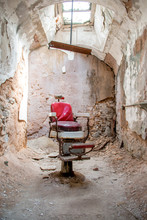 Old Barber Chair In An Abandoned Jail Cell