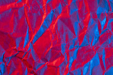 A Close Up Abstract Macro Photo Of Crumpled Creased Paper Lit With Red And Blue Flash Gels