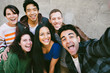 canvas print picture - Group of friends gather together to capture a selfie with happy expressions