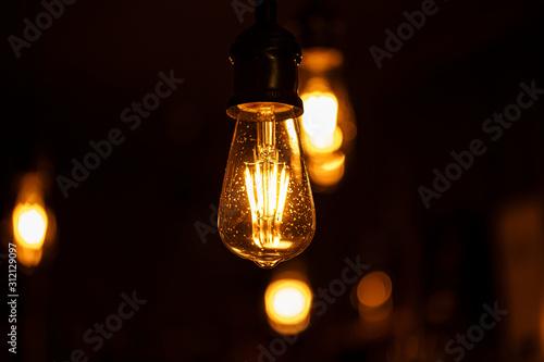 Obraz Close up glowing light bulb - fototapety do salonu