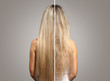 Woman before and after hair treatment on grey background, back view
