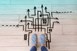 Leinwandbild Motiv Person standing on floor near arrows pointing in different directions, top view. Concept of choice