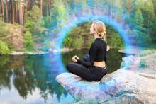 Beautiful Young Woman Meditating Near Lake