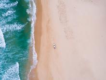 Car Driving On A Beach