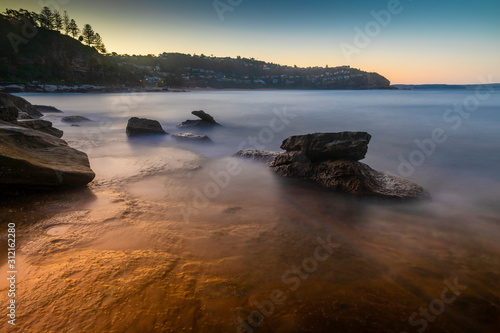 Sydney beach sunset with rock pools