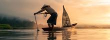 Fisherman Throwing Fishing Net During Sunrise.
