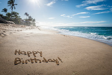 Happy Birthday Written In The Sand On Sunset Beach In Hawaii With Palm Trees And The Ocean In The Background
