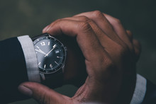 Looking At Luxury Watch On Han...