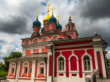 Moscow St. George Church In Red Color And Cloudy Background