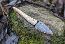 Flint Knife - Stone Age Tool (leaf Blade In Deer Antler) On Rock