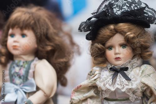 Closeup of vintage dolls at flea market in the street Wallpaper Mural