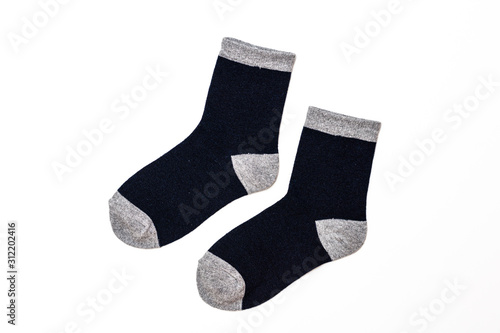 Photo A pair of toddler boy's socks, isolated on a white background/ Flat lay/ Top vie