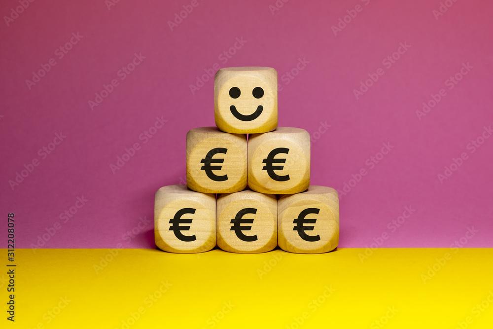 Fototapeta Pictogrammes de smiley heureux et euros sur cubes en bois