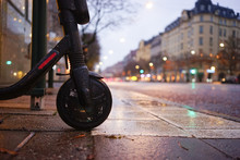 Electric Scooter On A Gray Day With Rain And Traffic