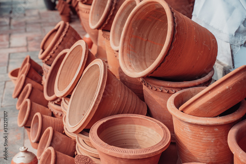 Terracotta clay planter pots for plants on sale at a street market in New Delhi India