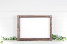Mock Up A4 Horizontal Frame Made Of Rough Wood With On A Shelf With Greens