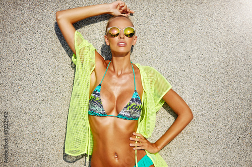 Fototapeta Summer fashion portrait of sexy woman with beautiful body in sunglasses
