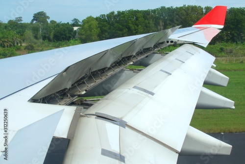 Jet plane air brakes and flaps fully extended after landing Canvas Print
