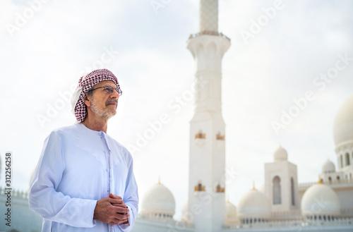 Arab man visiting the Grand Mosque in Abu Dhabi Canvas Print