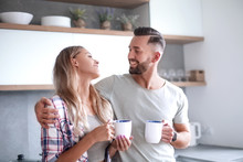 Young Couple Drinking Coffee S...