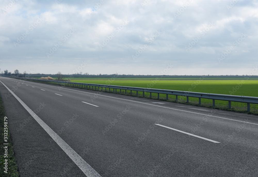 Fototapeta Beautiful view of asphalt highway without transport