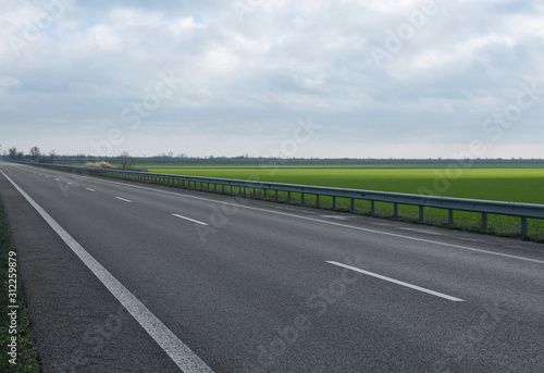 Beautiful view of asphalt highway without transport