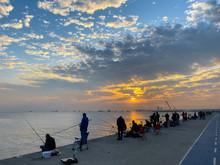 Fishermen Fishing At Sunset On...