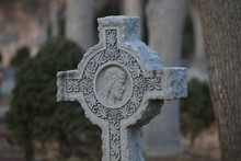 Old Stone Cross In Cemetery
