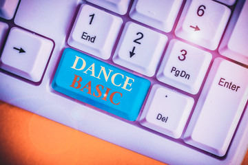 Conceptual hand writing showing Dance Basic. Concept meaning activity that utilizes the body and the range of movement White pc keyboard with note paper above the white background