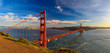 Panorama of the Golden Gate bridge with the Marin Headlands and San Francisco skyline at colorful sunset, California