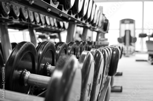 Close up of free weights inside fitness center or gym onboard luxury cruise ship liner