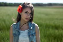 The Girl Has A Flower Poppy In...