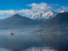 Single Sail Boat On Lake Como