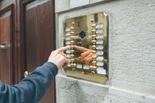 A Male Hand Presses A Doorphon...