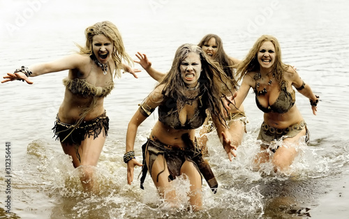 A group of four neanderthal women are on the attack Canvas Print