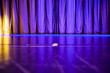 canvas print picture - Shiny and shimmering curtain closed on show stage of theatre or lounge on luxury cruise ship liner in shades of blue and purple