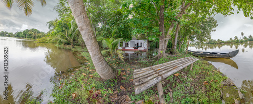 Photo Boat and Bench on Island in Kerala Backwaters