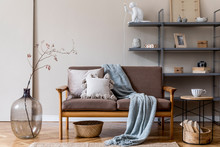 Modern Interior Design Of Living Room With Brown Wooden Sofa, Gray Bookstand, Glassy Vase With Flowers, Decoration And Elegant Accessories. Beige And Japandi Concept. Stylish Home Staging. Template.