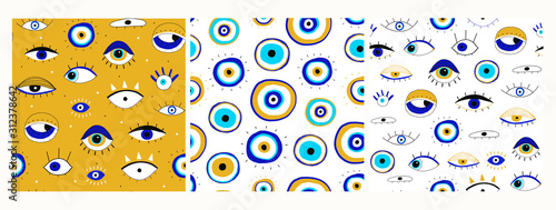 Set of three seamless patterns. Evil eyes. Hand drawn various talismans. Different shapes. Flat design. Free hand drawing style. Contemporary modern trendy vector illustrations.