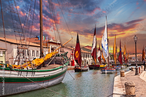 Cesenatico, Emilia Romagna, Italy: view at dawn of the port canal designed by Leonardo da Vinci in the ancient city on the Adriatic sea coast with the ancient wooden sailing boats